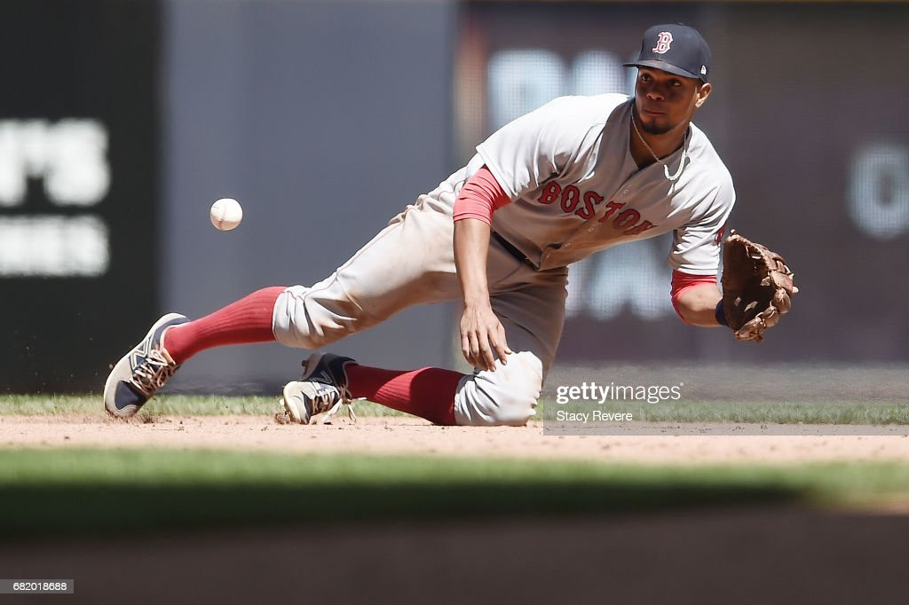 Xander Bogaerts #2 of the Boston Red Sox fields a line drive during the seventh inning of a game against the Milwaukee Brewers at Miller Park on May 11, 2017 in Milwaukee, Wisconsin.
