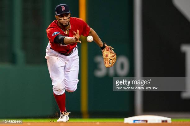 Xander Bogaerts of the Boston Red Sox flips the ball during the eighth inning of game two of the American League Division Series against the New York...