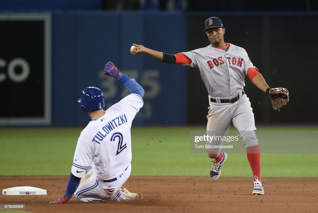 Xander Bogaerts #2 of the Boston Red Sox gets the force out of Troy Tulowitzki #2 of the Toronto Blue Jays at second base but cannot turn the double play in the seventh inning during MLB game action at Rogers Centre on April 18, 2017 in Toronto, Canada.
