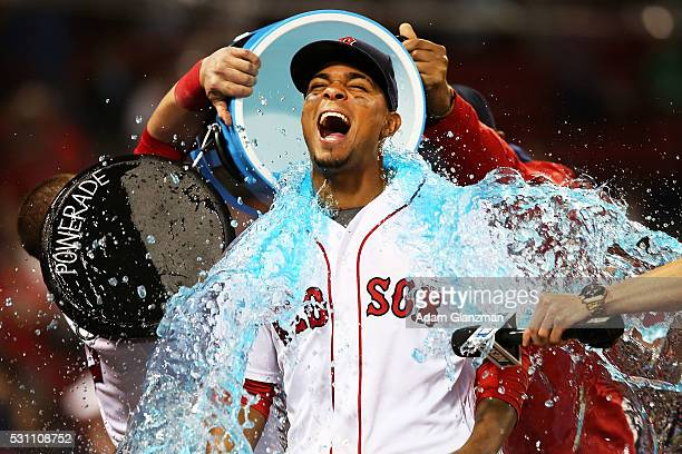 Xander Bogaerts of the Boston Red Sox has Powerade dumped on him after the victory over the Houston Astros at Fenway Park on May 12 2016 in Boston...