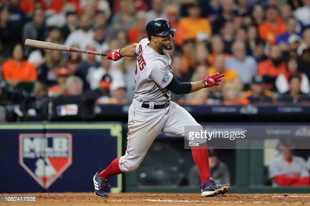Xander Bogaerts of the Boston Red Sox hits a RBI single in the fifth inning against the Houston Astros during Game Four of the American League...