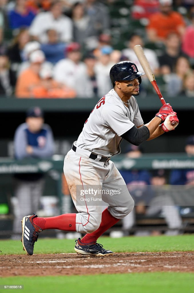 Xander Bogaerts #2 of the Boston Red Sox hits a single in the 12th inning against the Baltimore Orioles at Oriole Park at Camden Yards on June 11, 2018 in Baltimore, Maryland. Boston won the game 2-0.