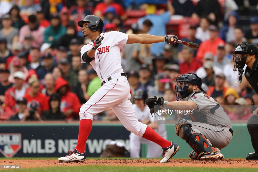 Xander Bogaerts #2 of the Boston Red Sox hits a solo home run in the first inning against the Houston Astros during game four of the American League Division Series at Fenway Park on October 9, 2017 in Boston, Massachusetts.