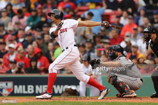 Xander Bogaerts of the Boston Red Sox hits a solo home run in the first inning against the Houston Astros during game four of the American League...