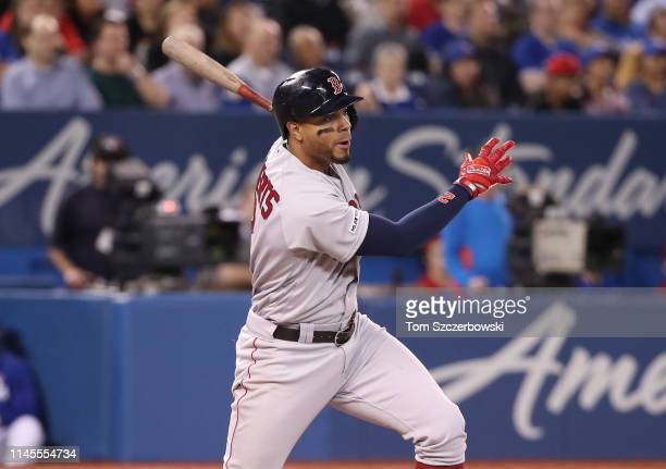 Xander Bogaerts of the Boston Red Sox hits an RBI single in the third inning during MLB game action against the Toronto Blue Jays at Rogers Centre on...