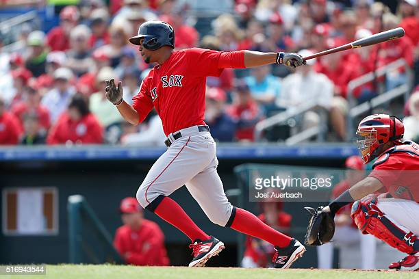 Xander Bogaerts of the Boston Red Sox hits the ball against the St Louis Cardinals during a spring training game at Roger Dean Stadium on March 21...