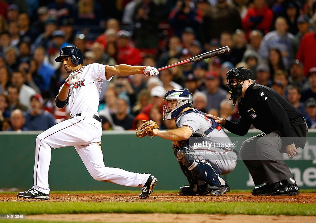Xander Bogaerts #2 of the Boston Red Sox hits the walk-off game-winning RBI single in the 9th inning against the Atlanta Braves during the game at Fenway Park on May 29, 2014 in Boston, Massachusetts.