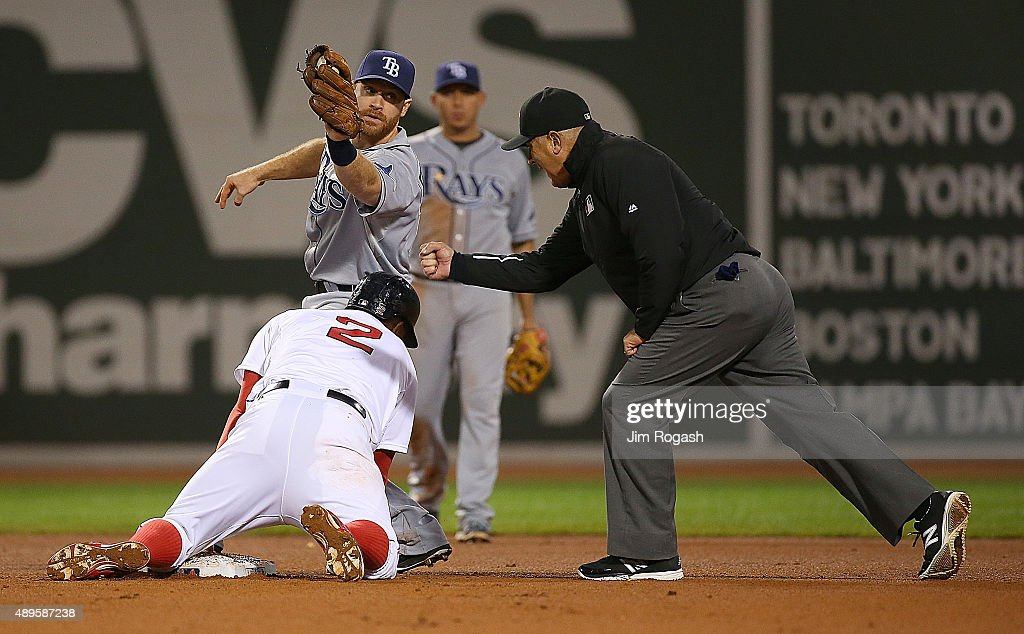 Xander Bogaerts #2 of the Boston Red Sox is called out after he slid into the tag by Logan Forsythe #11 of the Tampa Bay Rays in the eighth inning for the out attempting the double at Fenway Park on September 22, 2015 in Boston, Massachusetts.