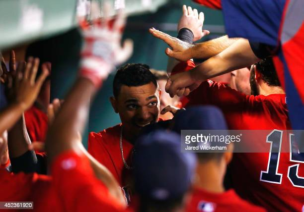 Xander Bogaerts of the Boston Red Sox is congratulated by teammates in the dugout after hitting a tworun home run in the sixth inning against the...