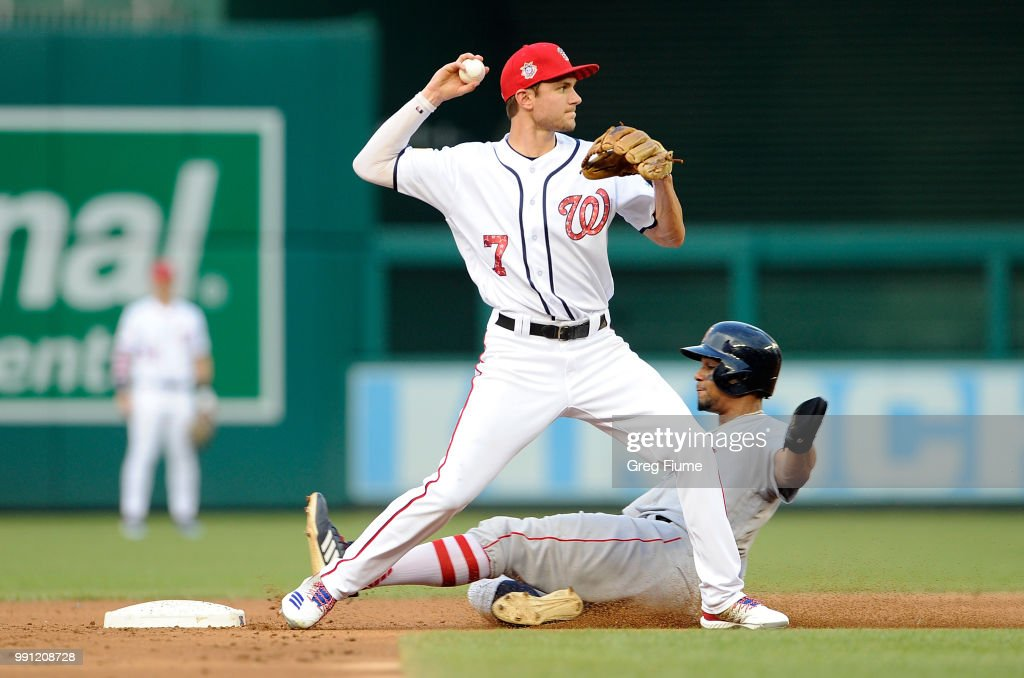 Xander Bogaerts #2 of the Boston Red Sox is forced out at second base in the second inning by Trea Turner #7 of the Washington Nationals at Nationals Park on July 3, 2018 in Washington, DC.