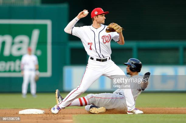 Xander Bogaerts of the Boston Red Sox is forced out at second base in the second inning by Trea Turner of the Washington Nationals at Nationals Park...