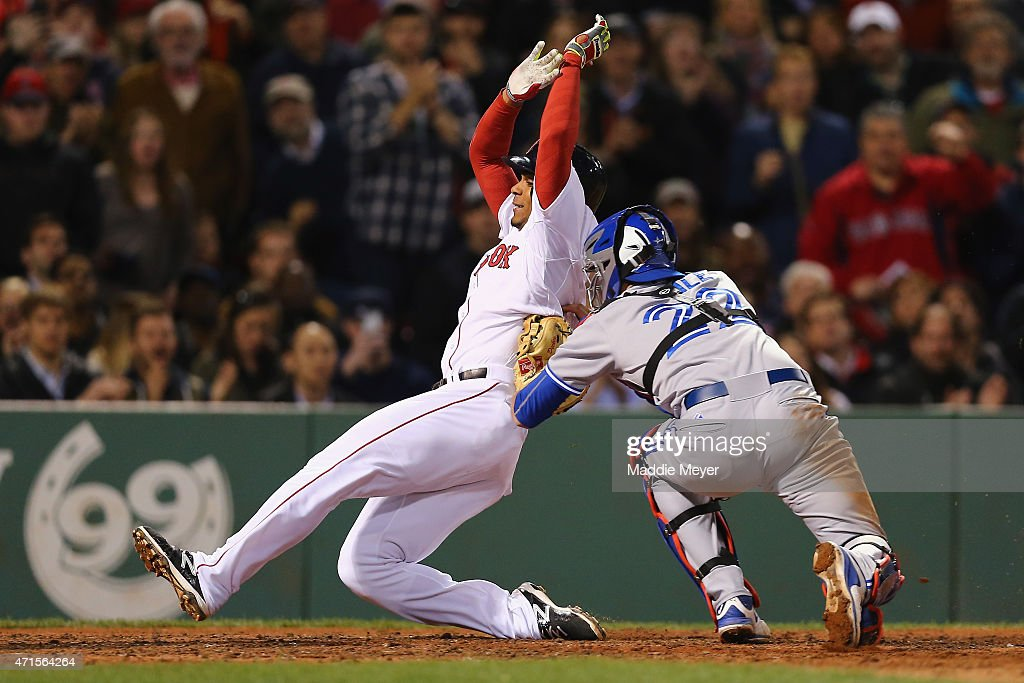 Xander Bogaerts #2 of the Boston Red Sox is tagged out at home by Josh Thole #22 of the Toronto Blue Jays during the seventh inning at Fenway Park on April 29, 2015 in Boston, Massachusetts.