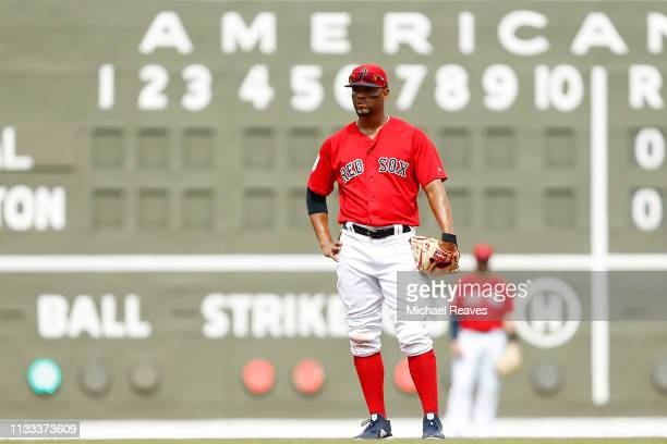 Xander Bogaerts of the Boston Red Sox looks on against the Baltimore Orioles during the Grapefruit League spring training game at JetBlue Park at...