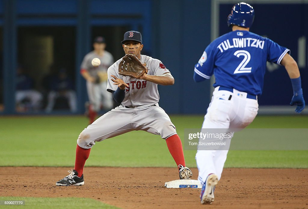 Xander Bogaerts #2 of the Boston Red Sox makes the putout at second base to force out Troy Tulowitzki #2 of the Toronto Blue Jays in the sixth inning during MLB game action on April 9, 2016 at Rogers Centre in Toronto, Ontario, Canada.