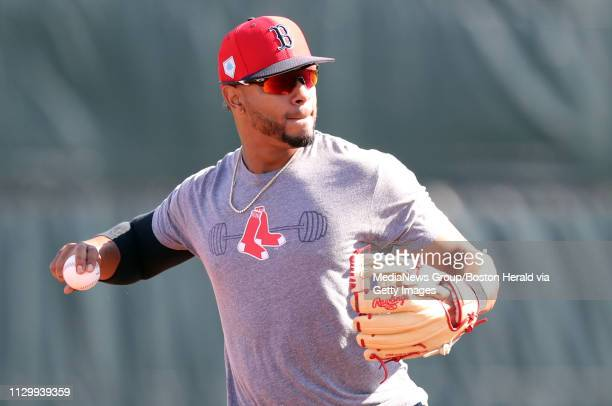Xander Bogaerts of the Boston Red Sox participates in an infielder drill during a spring training workout in Fort Myers Florida on February 15 2019