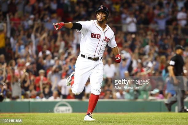Xander Bogaerts of the Boston Red Sox points towards the dugout after hitting a solo home run in the fourth inning of a game against the Cleveland...