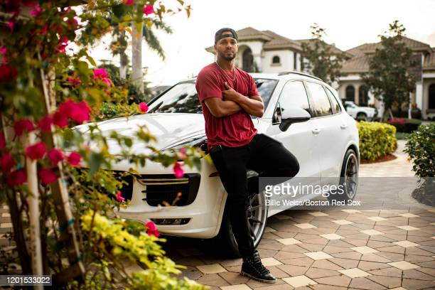 Xander Bogaerts of the Boston Red Sox poses for a portrait with his Porsche before riding into the ballpark before a team workout on February 17 2020...