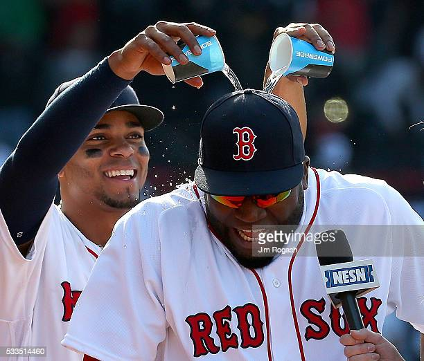 Xander Bogaerts of the Boston Red Sox pours water over David Ortiz of the Boston Red Sox after defeating the Cleveland Indians 52 at Fenway Park on...