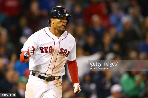 Xander Bogaerts of the Boston Red Sox pumps his fist during a game against the Chicago Cubs at Fenway Park on April 30 2017 in Boston Massachusetts