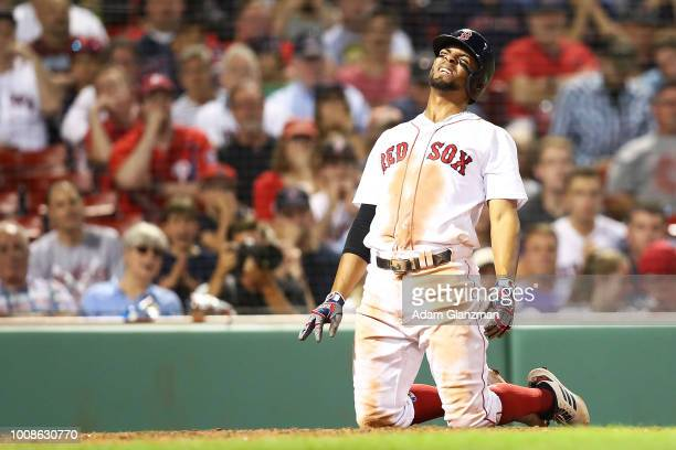 Xander Bogaerts of the Boston Red Sox reacts after being hit by a pitch in the ninth inning of a game against the Philadelphia Phillies at Fenway...