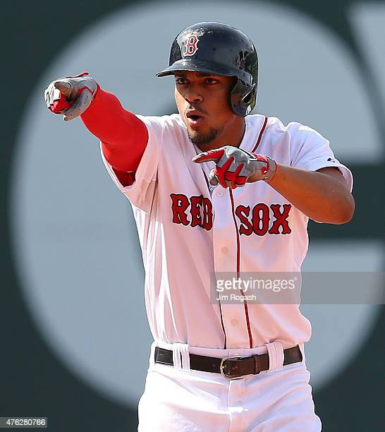 Xander Bogaerts of the Boston Red Sox reacts after he doubled in to two runs for the lead in the seventh inning against the Oakland Athletics at...