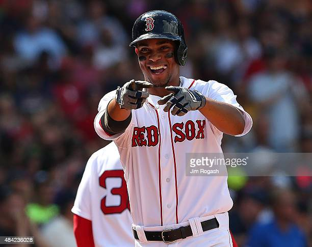 Xander Bogaerts of the Boston Red Sox reacts after his home run in the third inning against the Seattle Mariners at Fenway Park on August 16 2015 in...