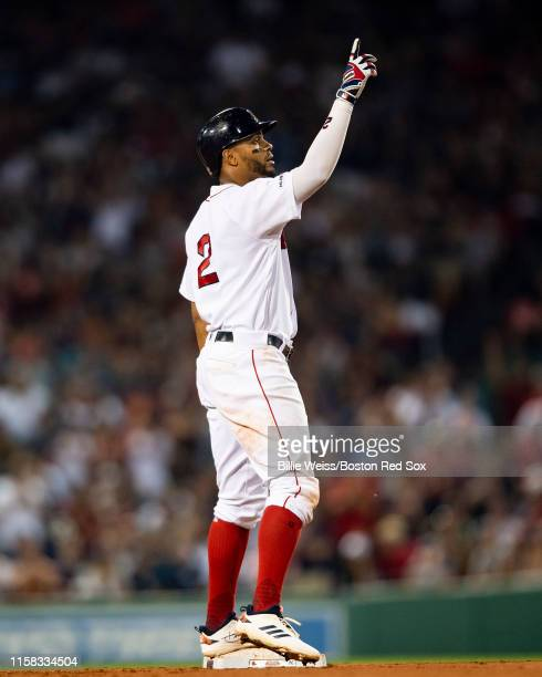 Xander Bogaerts of the Boston Red Sox reacts after hitting a double during the sixth inning of a game against the New York Yankees on July 28 2019 at...