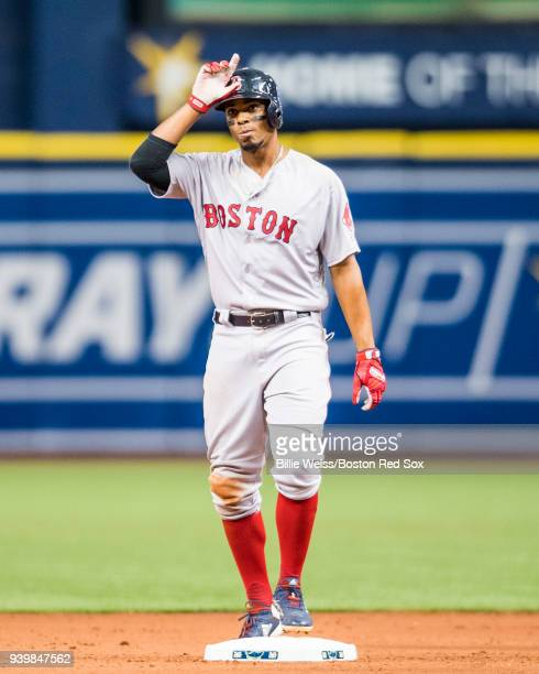 Xander Bogaerts of the Boston Red Sox reacts after hitting a double during the seventh inning of the Opening Day game against the Tampa Bay Rays on...