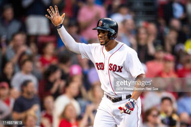 Xander Bogaerts of the Boston Red Sox reacts after hitting a solo home run during the first inning of a game against the Texas Rangers on June 11...