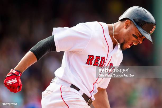 Xander Bogaerts of the Boston Red Sox reacts after hitting a walkoff grand slam home run during the tenth inning of a game against the Toronto Blue...