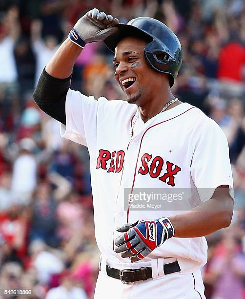 Xander Bogaerts of the Boston Red Sox reacts after hitting the game winning single allowing Mookie Betts to score defeating the Chicago White Sox 87...