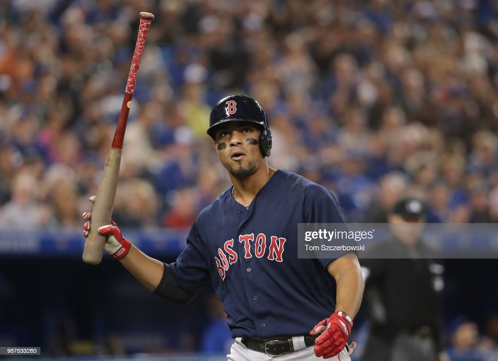 Xander Bogaerts #2 of the Boston Red Sox reacts after popping out in the eighth inning during MLB game action against the Toronto Blue Jays at Rogers Centre on May 11, 2018 in Toronto, Canada.