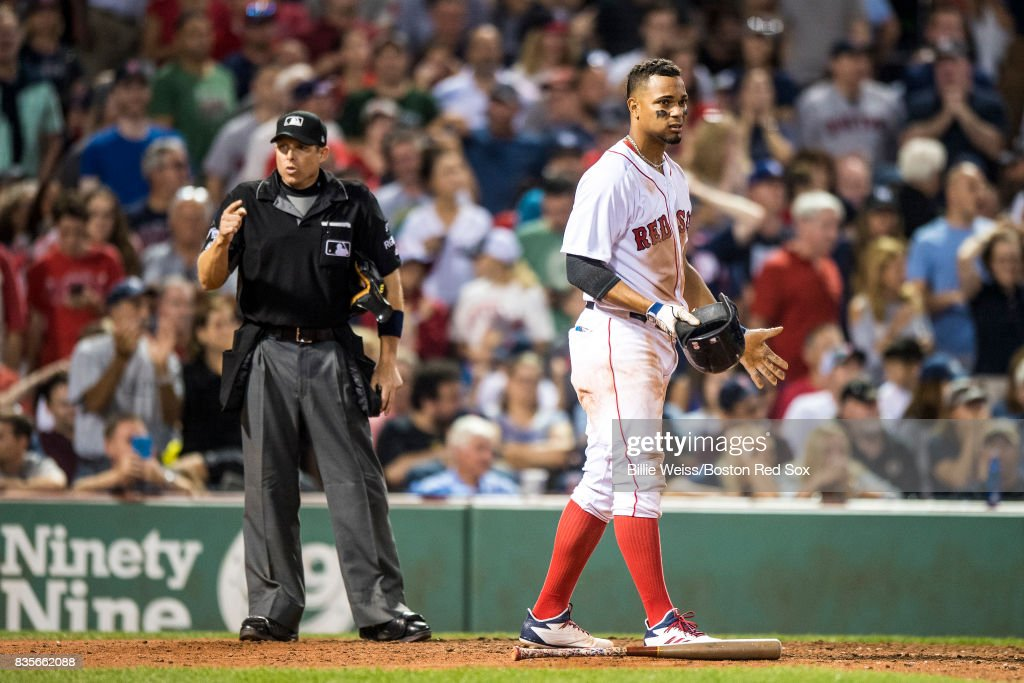 Xander Bogaerts #2 of the Boston Red Sox reacts after striking out during the eighth inning of a game against the New York Yankees on August 19, 2017 at Fenway Park in Boston, Massachusetts.