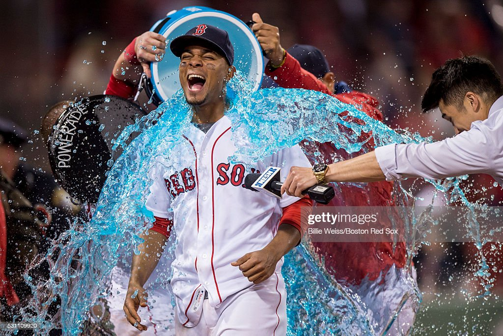 Xander Bogaerts #2 of the Boston Red Sox reacts as a tub of Powerade is poured on him following a victory against the Houston Astros on May 12, 2016 at Fenway Park in Boston, Massachusetts.
