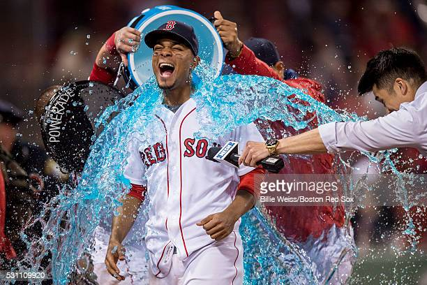 Xander Bogaerts of the Boston Red Sox reacts as a tub of Powerade is poured on him following a victory against the Houston Astros on May 12 2016 at...