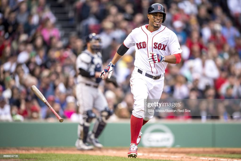 Xander Bogaerts #2 of the Boston Red Sox reacts as he hits a single during the seventh inning of a game against the Tampa Bay Rays on April 15, 2017 at Fenway Park in Boston, Massachusetts. All players are wearing #42 in honor of Jackie Robinson Day.
