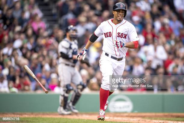 Xander Bogaerts of the Boston Red Sox reacts as he hits a single during the seventh inning of a game against the Tampa Bay Rays on April 15 2017 at...
