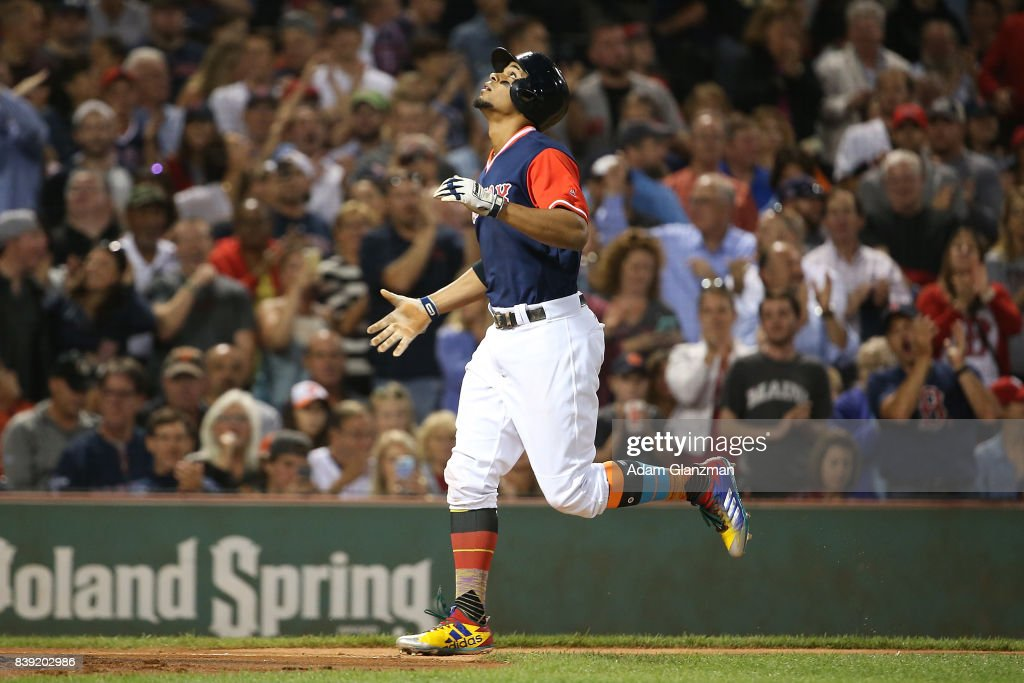 Xander Bogaerts #2 of the Boston Red Sox reacts as he rounds the bases after hitting a two-run home run in the second inning of a game against the Baltimore Orioles at Fenway Park on August 25, 2017 in Boston, Massachusetts.