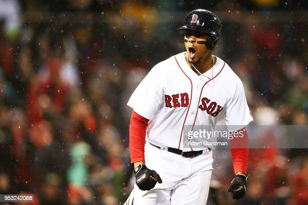 Xander Bogaerts of the Boston Red Sox reacts as he rounds the bases after hitting a grand slam in the third inning of a game against the Kansas City...