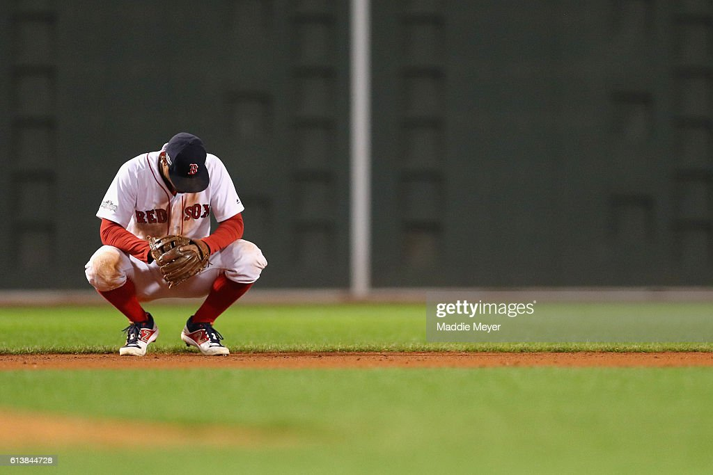 Xander Bogaerts #2 of the Boston Red Sox reacts in the ninth inning against the Cleveland Indians during game three of the American League Divison Series at Fenway Park on October 10, 2016 in Boston, Massachusetts.