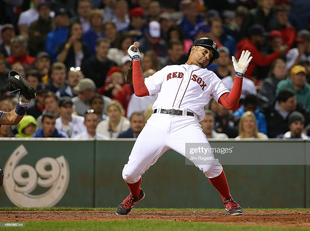 Xander Bogaerts #2 of the Boston Red Sox reacts to an inside pitch in the fifth inning against the Tampa Bay Rays at Fenway Park on September 22, 2015 in Boston, Massachusetts.