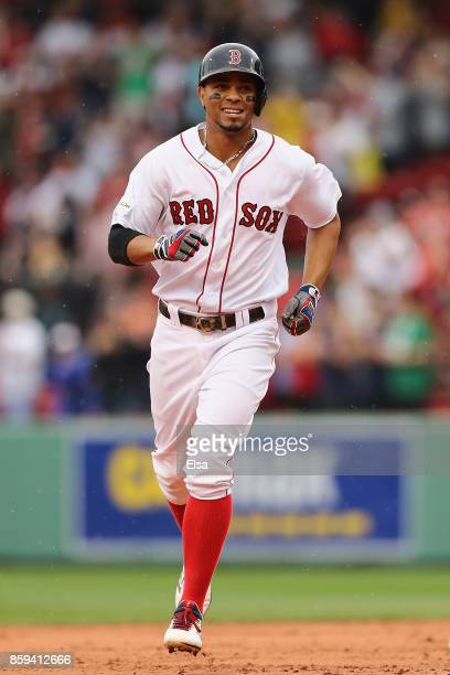 Xander Bogaerts of the Boston Red Sox runs the bases after hitting a solo home run in the first inning against the Houston Astros during game four of...