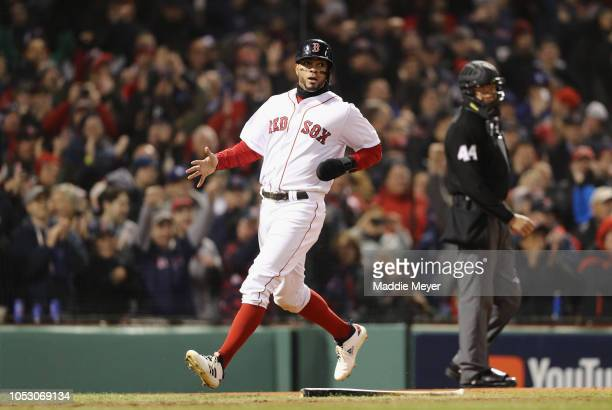 Xander Bogaerts of the Boston Red Sox scores a first inning run against the Los Angeles Dodgers in Game Two of the 2018 World Series at Fenway Park...