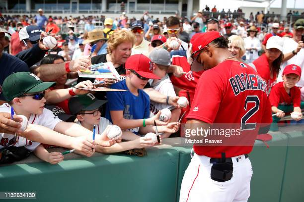 Xander Bogaerts of the Boston Red Sox signs autographs for fans prior to the Grapefruit League spring training game against the Baltimore Orioles at...