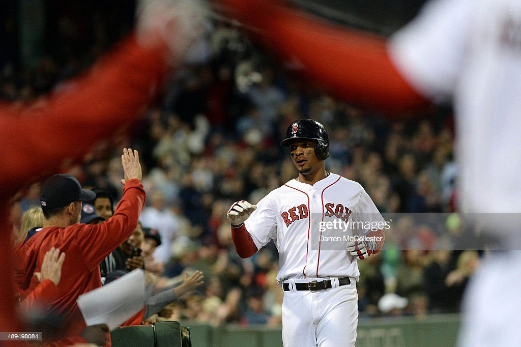 Xander Bogaerts #2 of the Boston Red Sox slaps high fives after scoring the go ahead run in the seventh inning against the Tampa Bay Rays at Fenway Park on September 21, 2015 in Boston, Massachusetts.