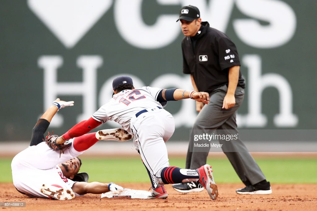 Xander Bogaerts #2 of the Boston Red Sox slides into second past Francisco Lindor #12 of the Cleveland Indians during the second inning at Fenway Park on August 14, 2017 in Boston, Massachusetts.