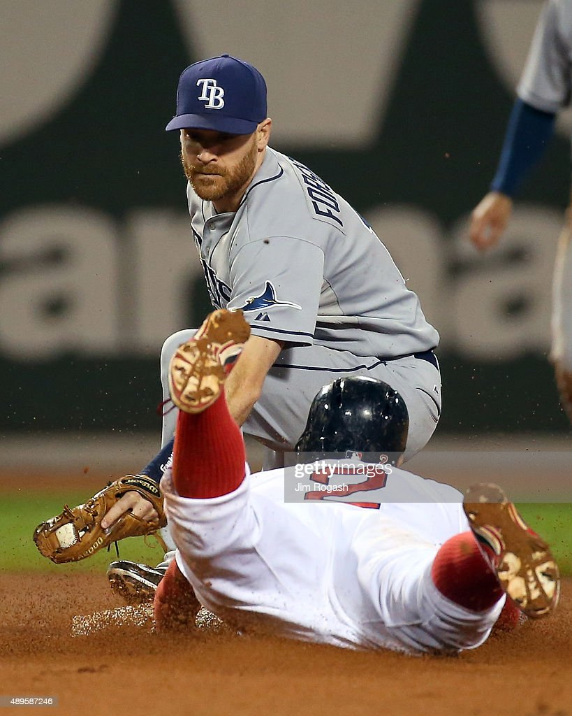Xander Bogaerts #2 of the Boston Red Sox slides into the tag by Logan Forsythe #11 of the Tampa Bay Rays in the eighth inning for the out attempting the double at Fenway Park on September 22, 2015 in Boston, Massachusetts.