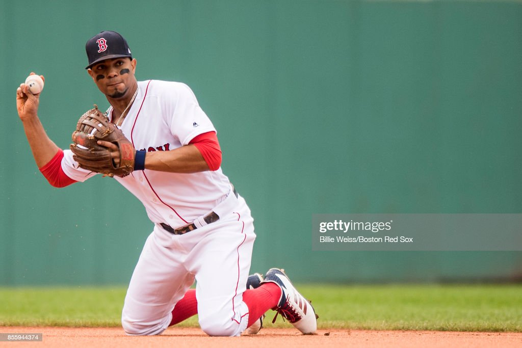 Xander Bogaerts #2 of the Boston Red Sox starts a double play from his knees during the second inning of a game against the Houston Astros on September 30, 2017 at Fenway Park in Boston, Massachusetts.