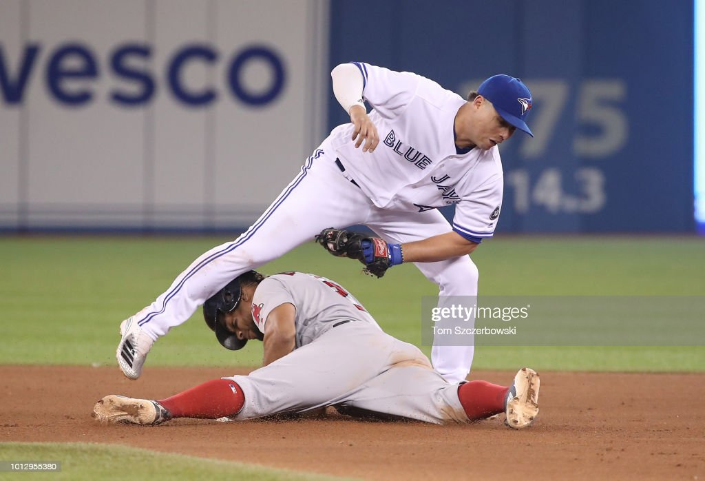 Xander Bogaerts #2 of the Boston Red Sox steals second base in the 10th inning during MLB game action as Aledmys Diaz #1 of the Toronto Blue Jays makes the late tag at Rogers Centre on August 7, 2018 in Toronto, Canada.