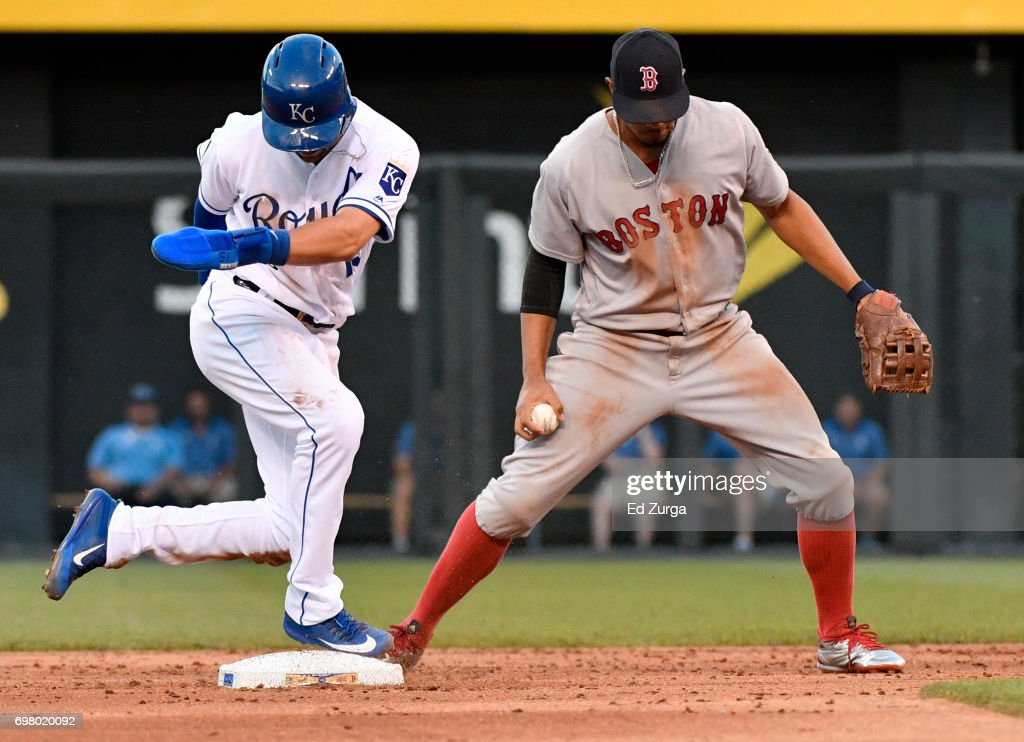 Xander Bogaerts #2 of the Boston Red Sox steps on second as the gets the force out on Whit Merrifield #15 of the Kansas City Royals in the third inning at Kauffman Stadium on June 19, 2017 in Kansas City, Missouri.